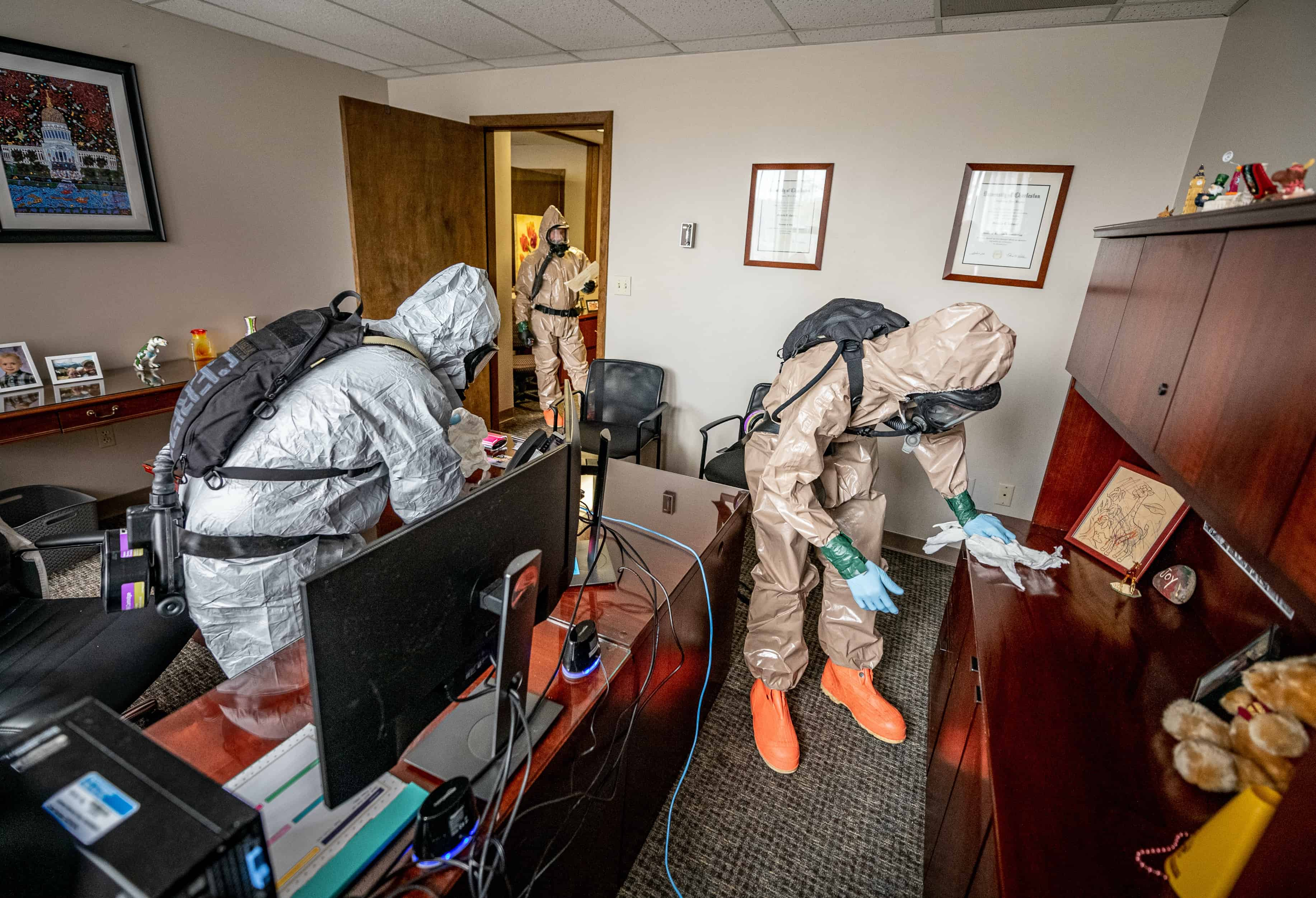 The West Virginia National Guard disinfecting an office